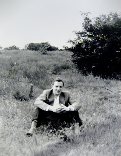 Jan Duyn sitting in a field. black and white photo from the 1960's