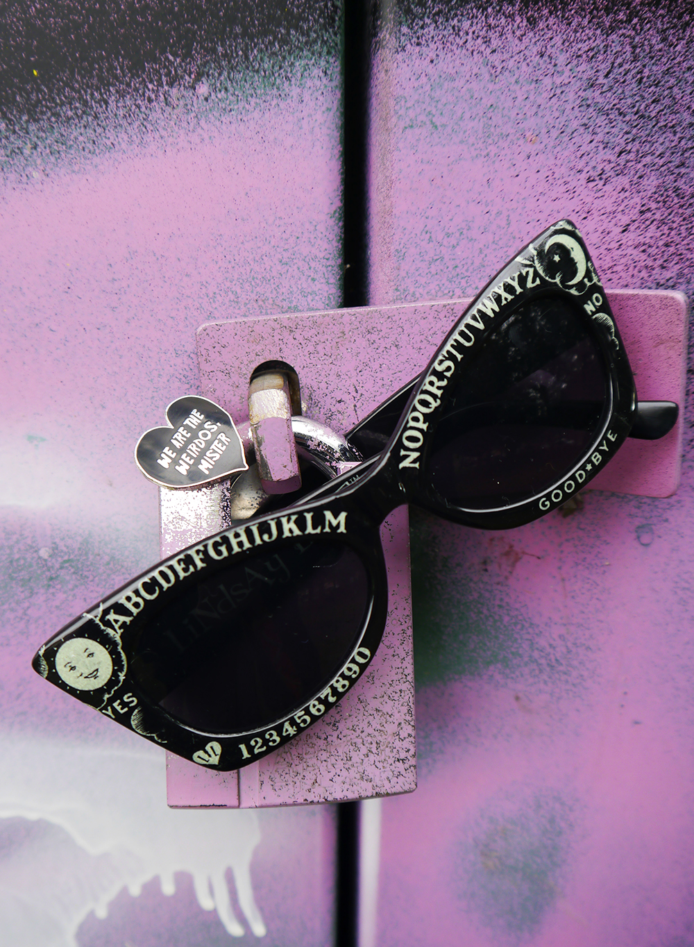 The Craft enamel pin and ouija board sunglasses - accessories for a Nancy Downs inspired Halloween costume