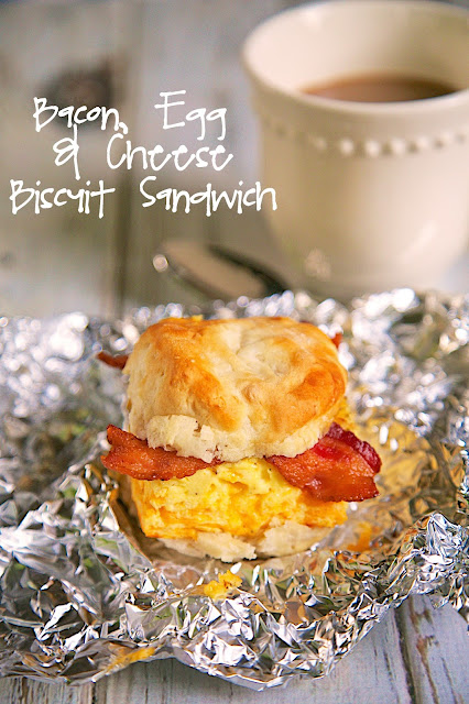 Bacon, Egg & Cheese Biscuit Sandwich Recipe - biscuit topped with a cheesy baked egg casserole and bacon - SO good! Can assemble the biscuits ahead of time and reheat the next morning for a quick on-the-go breakfast. SO much better than the drive-thru!