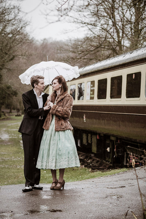 vintage+mad+men+retro+wedding+engagement+portraits+train+station+fur+parasol+rainy+day+rustic+unique+offbeat+classic+wedding+bride+groom+charlene+morton+photography+5 - Engaging Train Ride