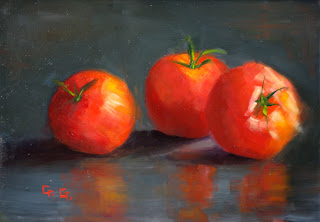 small beautiful oil painting of three tomatoes on a panel