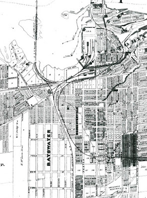 Large section of map between of the west side of the Ottawa area with extents Concession St (Bronson, East), Carling Avenue (South), Centre St (Stirling, West), and the Chaudière islands (North). Individual properties are shown and numbered (not necessarily reflecting any construction thereon) for most blocks except west of the tracks (O Train Trillium Line) and south of Laurel Street in Bayswater. The Ottawa and St. Lawrence R.R. (CPR) comes up from the middle of the south end of the map up along the current O-Train Trillium Line alignment before splitting just south of Richmond Road into parts that go north (over the Lemieux Island rail bridge) and east (into LeBreton Flats), the latter of which also splits into a roundhouse just north of Richmond and a westbound rail line just north of future Scott Street. The Canadian Atlantic Railway line travels over many parcels of land as though it were drawn after the properites were subdivided. It comes in from the right side of the map near Bronson and Catherine and goes west before turning north parallel to the CPR line and turning east to cross Richmond Road and follow the north side of Richmond Road and splits into two tracks at the Broad Street station, one of which continues east up around LeBreton Flats along the north side of the Aqueduct and then crosses Bridge St westbound before going onto the west side of Chaudière island. Wellington Street is labelled in the diagonal section east of the Richmond/Wellington/Broad/Rochester intersection. West of that intersection is labelled Richmond Road up to the point where Richmond splits off southwest into Hintonburg. The road alignment continues west toward Scott Street, which is labelled as 'Road Allowance Between Con. A & First Con.'