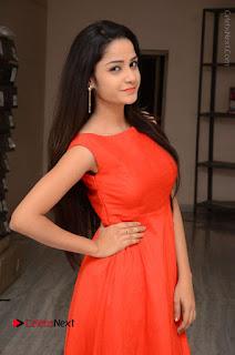 Telugu Actress Divya Nandini Stills in Orange Sleeveless Gown at Chennai Chaitrama Movie le Launch Event  0014.JPG