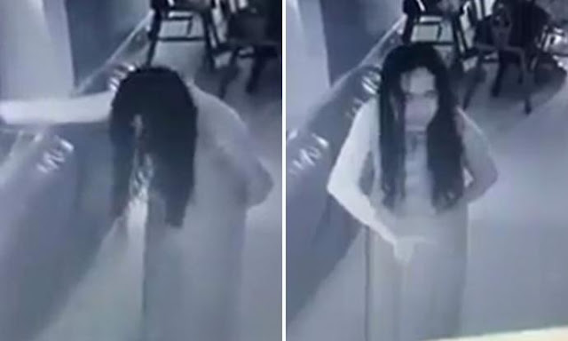 Security camera footage captures a maid in Singapore who seems to be possessed by a ghost or demon.