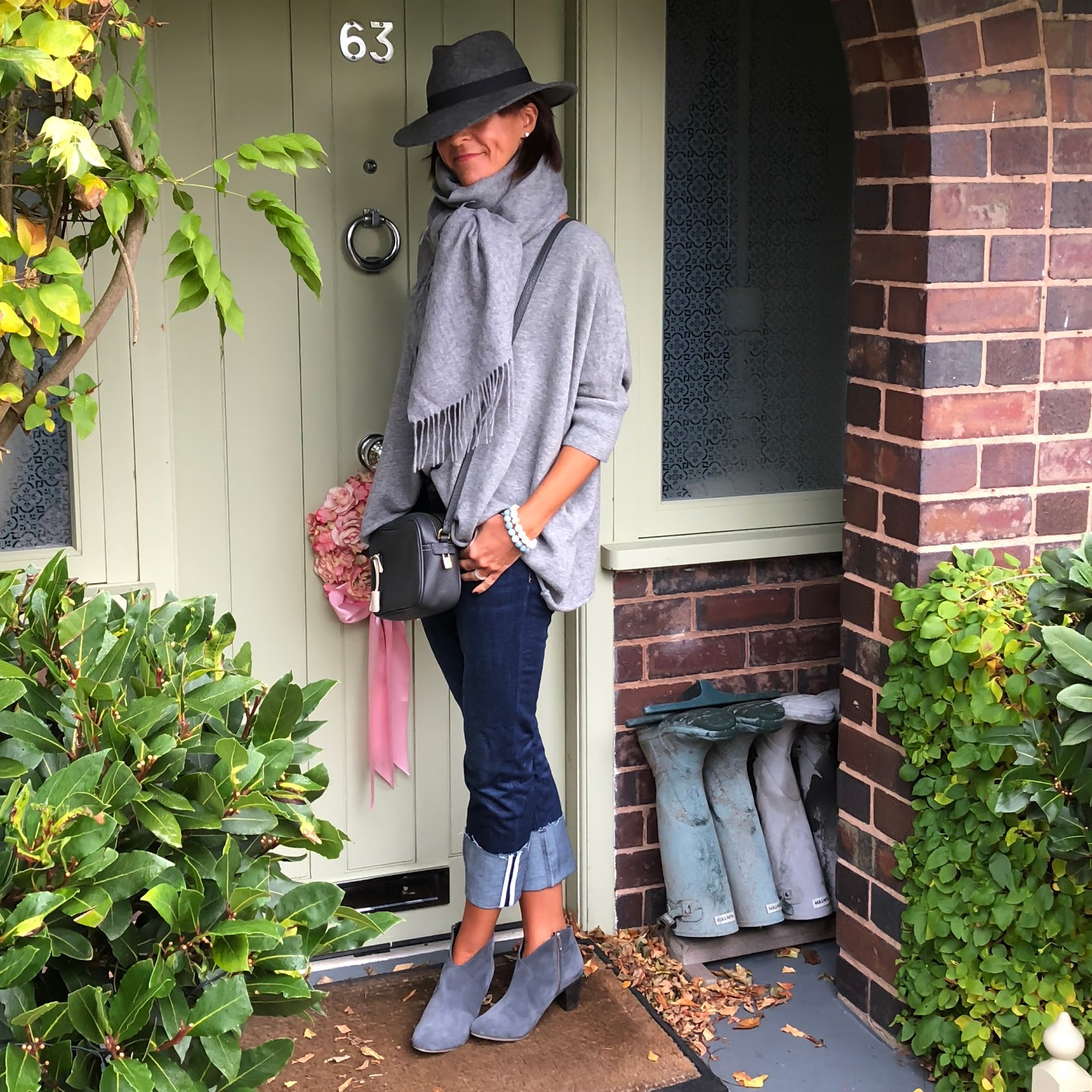 my midlife fashion, italy in cashmere light grey pure cashmere short sleeev oversized batwing sweater, hush thornton ankle boots, hush turn up boyfriend jeans, asos oversized wool scarf, zara felt trilby, j crew leather cross body bag
