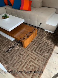 luxurious hand-tufted rug in wool and silk displayed at client living area