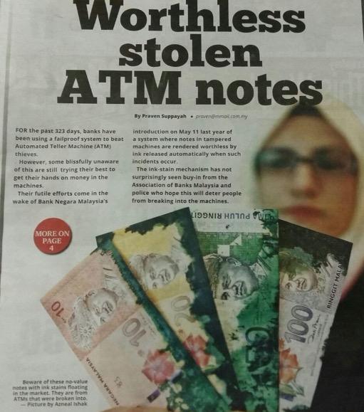 Wang Kertas Berdakwat Dicuri Dari Mesin ATM