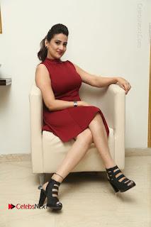 Telugu Tollywood Anchor Manjusha Pos in Red Short Dress  0110.JPG