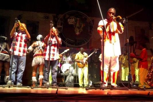 Femi Kuti's two young sons join him on stage to perform
