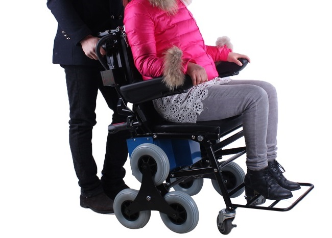 person sitting on climbing wheelchair