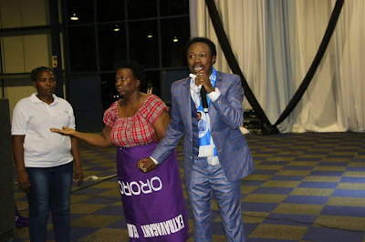Prophet Joshua Iginla gives $1000 to a poor widow and offers scholarship to her son in Botswana