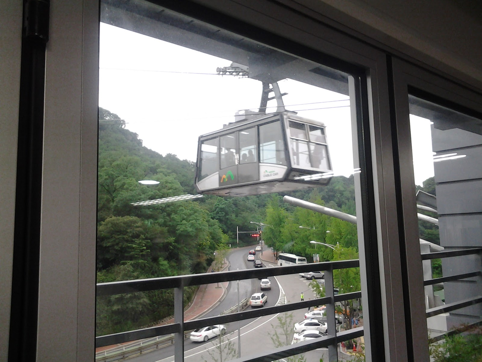 Namsan cable car -  Inclined Elevator Which Runs Between The Front Of The Namsan Tunnel And The Cable Car Platform The Namsan Cable Car Is Transparent On All Sides