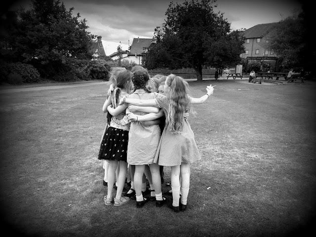 old friends giving sasha a group hug