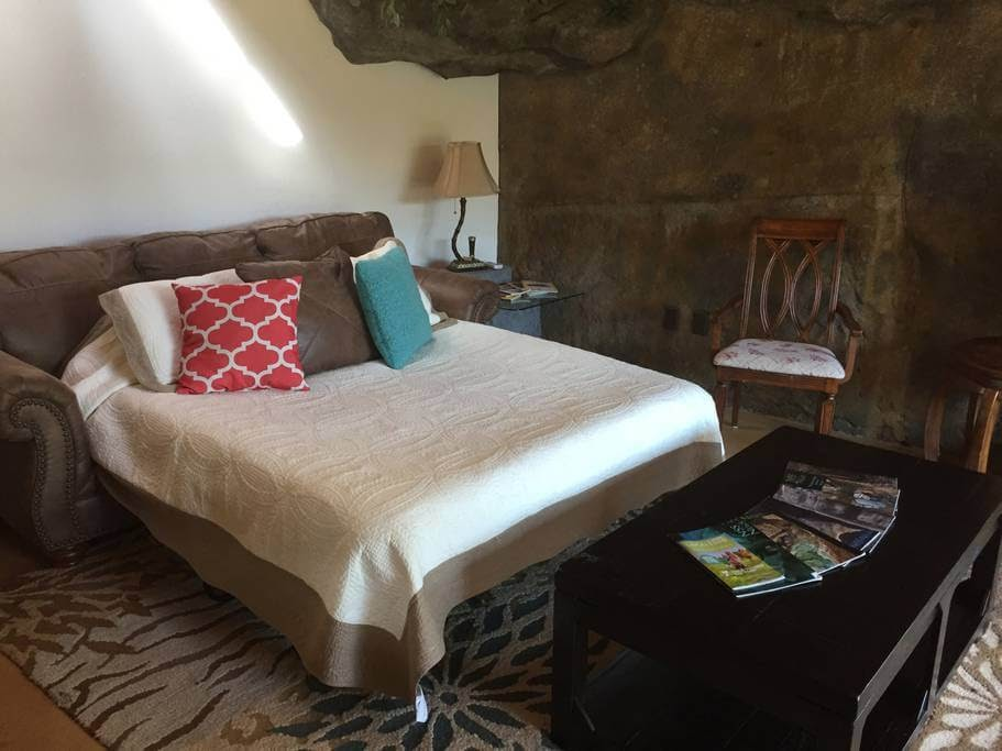 04-Guest-Bedroom-airbnb-The-Bedrock-Cave-Cottage-Architecture-www-designstack-co