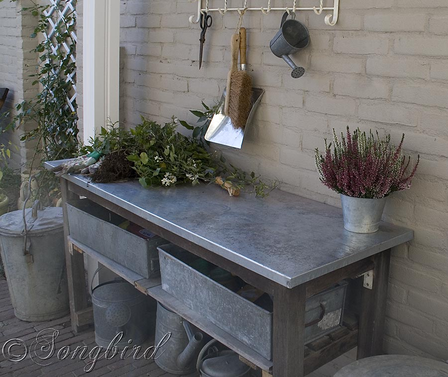 Vintage coat rack finishes a garden work area with a work ...