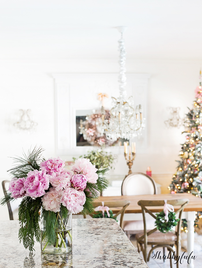 pink peonies and a christmas tree