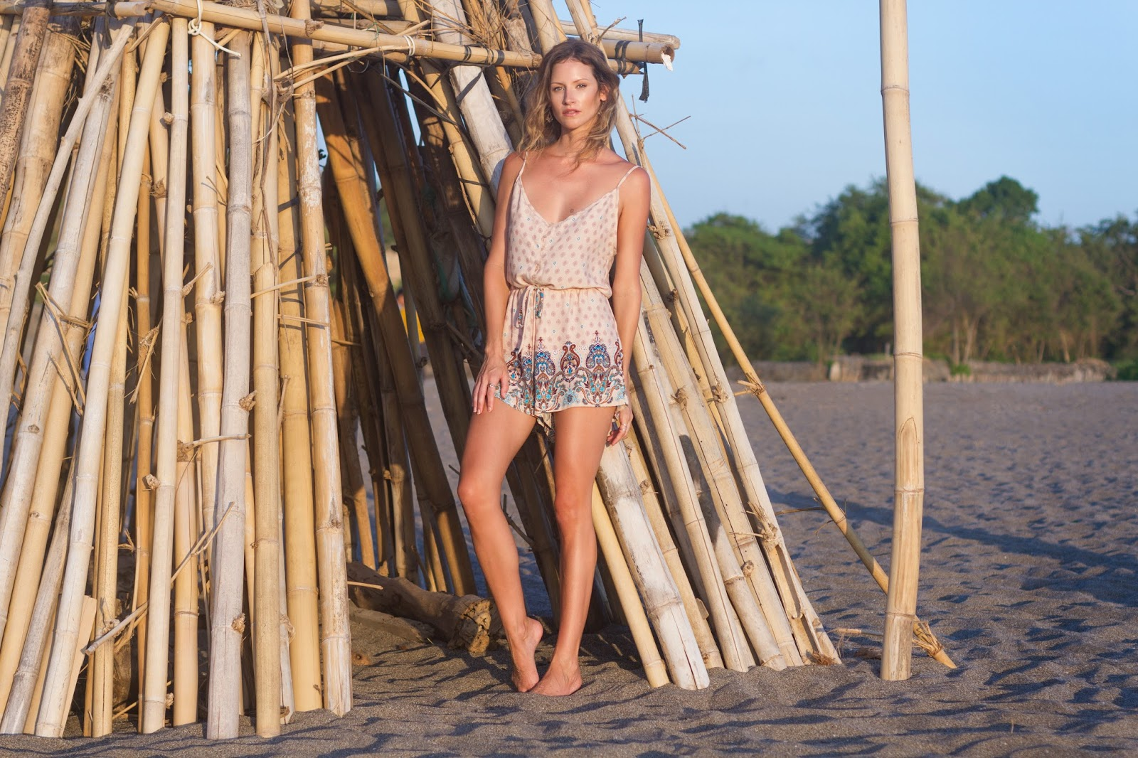 fashion blogger and designer, Alison Hutchinson, is wearing a KAYVALYA Ruko Romper in Bali, Indonesia