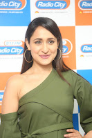 Pragya Jaiswal in a single Sleeves Off Shoulder Green Top Black Leggings promoting JJN Movie at Radio City 10.08.2017 125.JPG