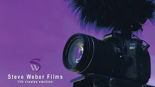 Steve Weber Films logo with black camera against a purple background