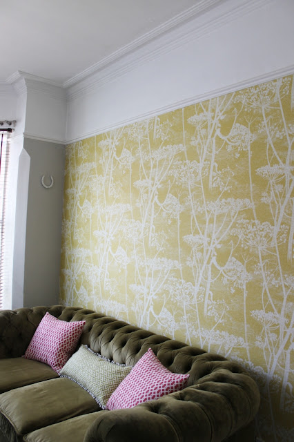 Not sure whether to paint above the picture rail or not? Take a look at the before and after pictures from my living room.