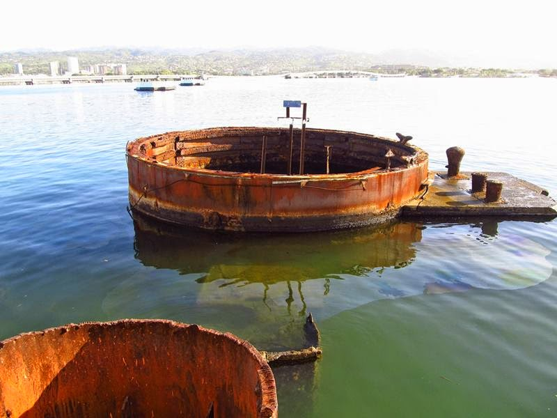 The USS Arizona Memorial is built over the sunken wreckage of the USS Arizona, the final resting place for many of the 1,177 crewmen killed on December 7, 1941 when Japanese Naval Forces bombed Pearl Harbor.
