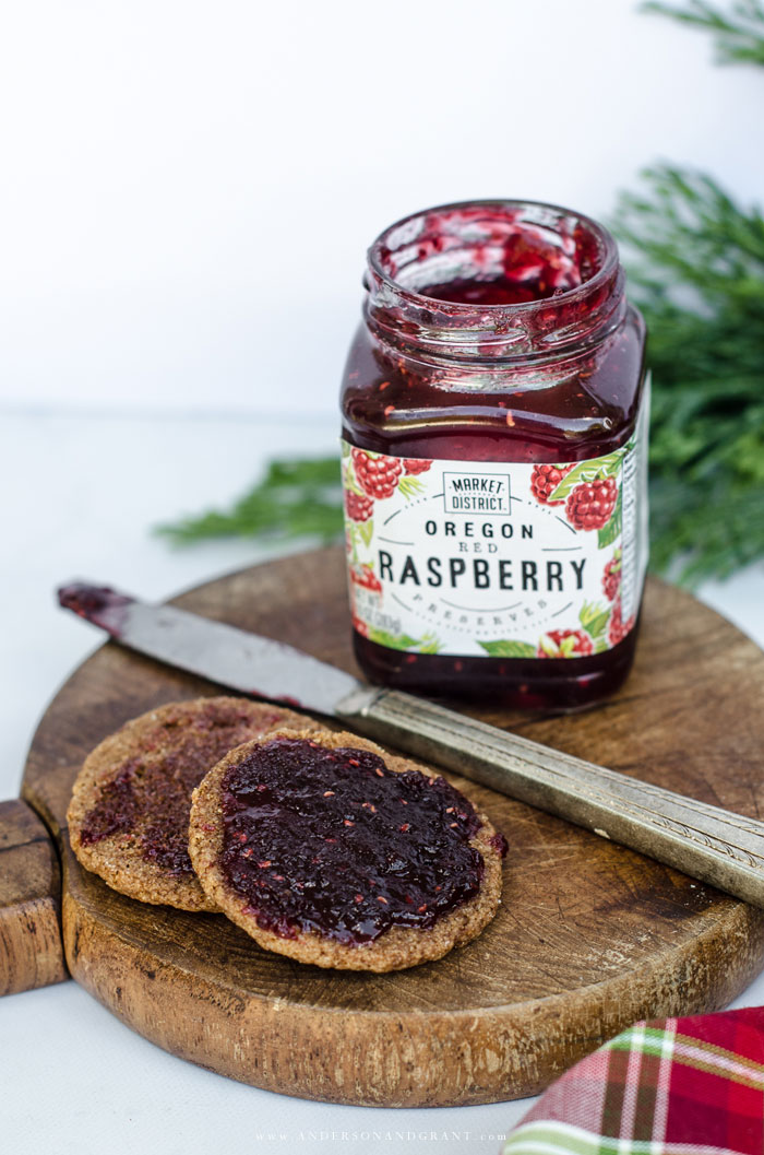 Raspberry Jam spread on gingersnap cookies