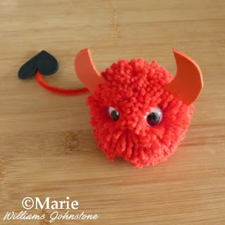Devilish character starting to form from the yarn craft