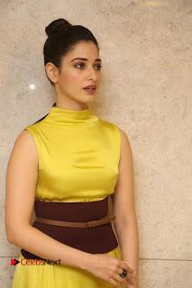 Actress Tamanna Stills in Yellow Dress at Okkadochadu Audio Launch  0173