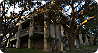 The back of the Bobcat Run house at sunset.