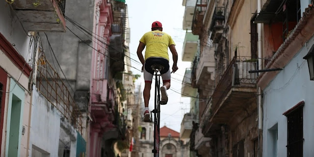 NEWS | Cubans Rides Around Advertising Rules on Towering Bikes