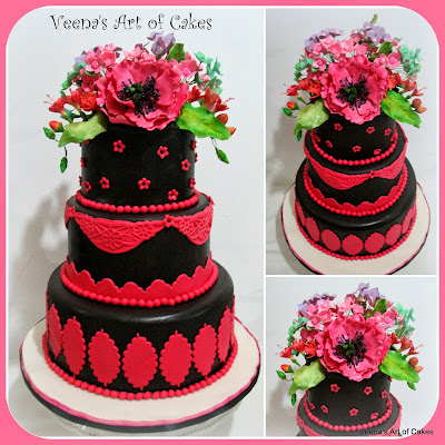 A pink and black wedding cake.