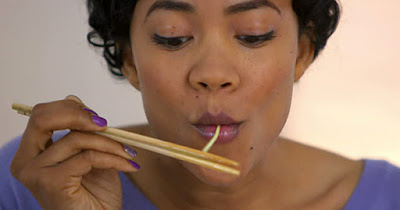 Black woman eating curry