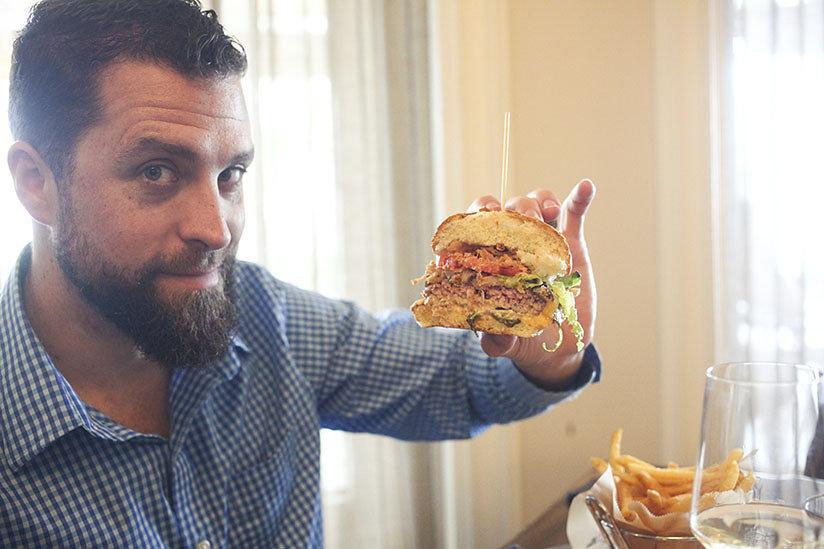 David West holding Bistro Burger