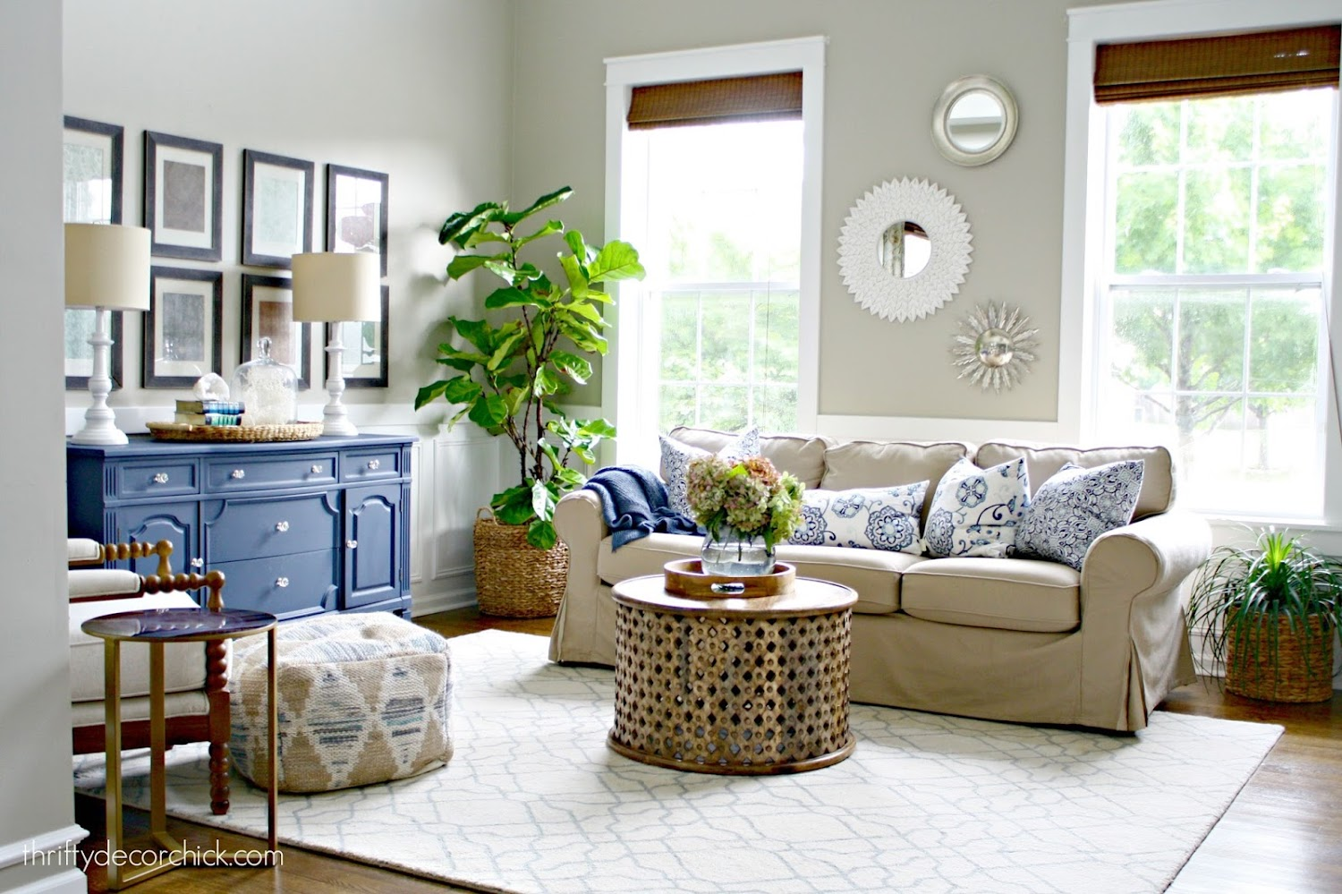 living room with neutral upholstered couch