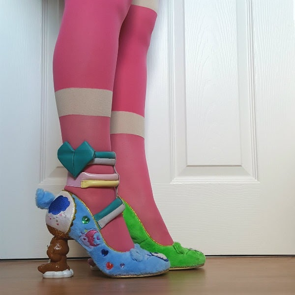 legs wearing bright pink tights and heart strappy ankle cuff with care bear furry court shoes