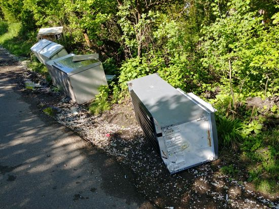 Photograph of 13 fridge freezers dumped at the western end of Bradmore Lane Image by North Mymms News released under Creative Commons BY-NC-SA 4.0