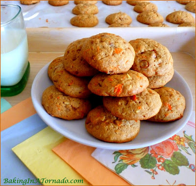 Cinnamon Toffee Carrot Cookies, a chewy cookie featuring many flavors of a carrot cake with a few surprises. If you like a cookie that's not overly sweet, this is the one for you. | Recipe developed by www.BakingInATornado.com | #recipoe #cookies #bake