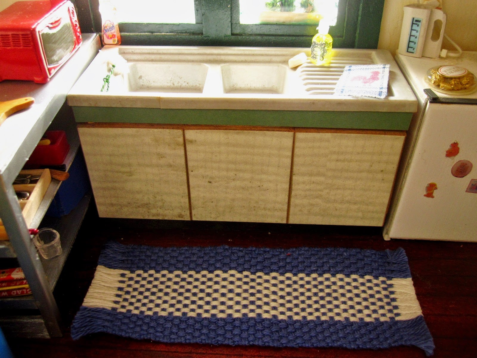 Modern dolls' house miniature kitchen sink unit.