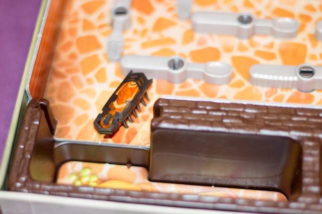 Close up of the Hexbug Nano about to fall into one of the 4 traps around the board