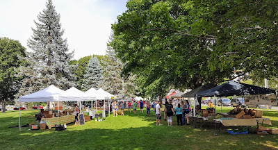 two rows of vendors at the Franklin Farmers Market in July