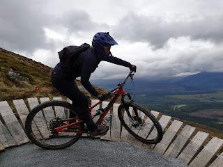 woman mountain biking with commuter bag