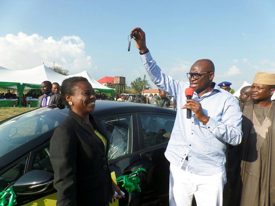 Photos fayose presents brand new car to woman after emerging best