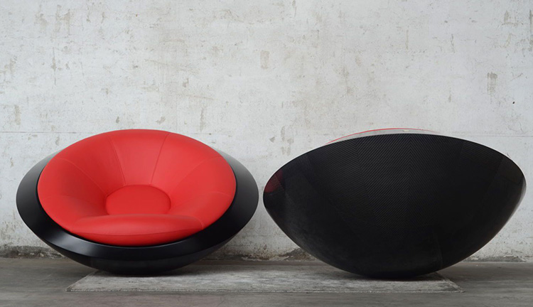 This futuristic chair rocks spins and flips