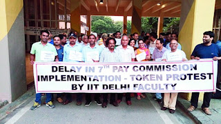 IIT Delhi faculty members hold the protest march inside the campus on Tuesday evening