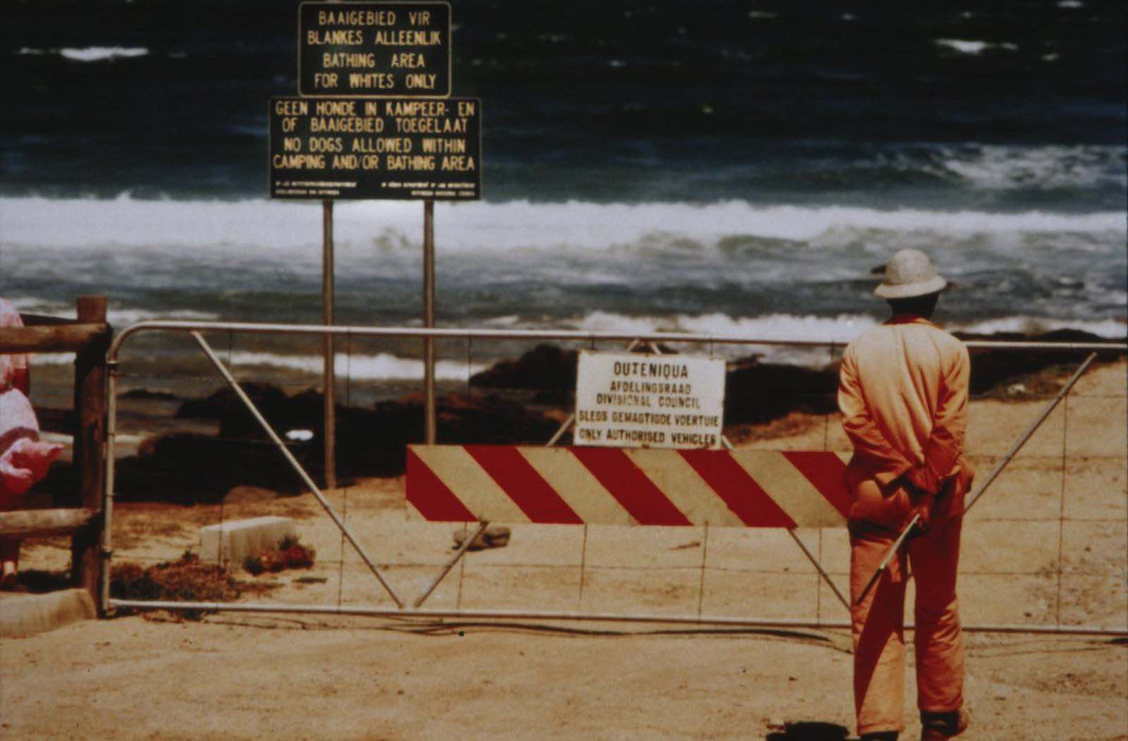 A sign reading 'Bathing area for Whites Only' on a beach at Victoria Bay, Western Cape. 1988.