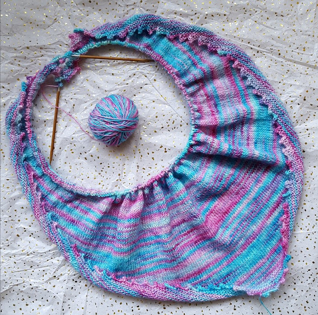 Beautiful hand knitted shawl in luxury hand-dyed yarn.
