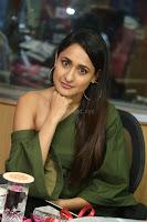 Pragya Jaiswal in a single Sleeves Off Shoulder Green Top Black Leggings promoting JJN Movie at Radio City 10.08.2017 040.JPG