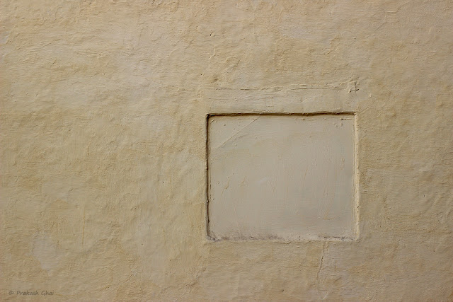 A Minimalist Photo of a Hollow Square on a Textured Brown Indian Wall.