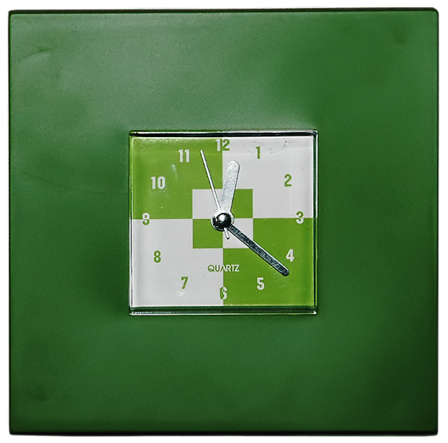 A modern battery operated clock with a square face.