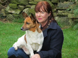 Portrait of Jane Gething-Lewis with one of her dogs